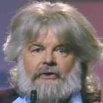 Benny as Kenny Rogers in 'The Monte Carbolic Show'